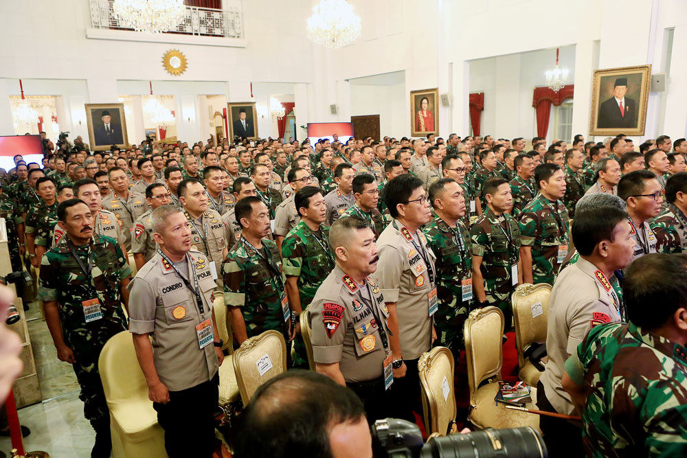 Old brothers under fire; revisiting TNI-Police ties